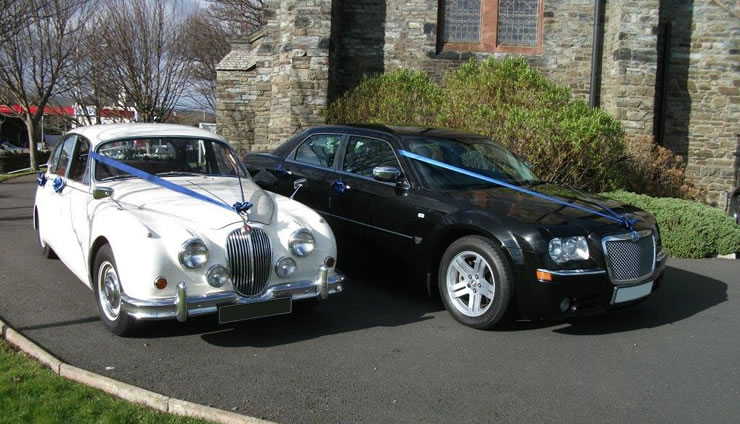 Jaguar Mark 2 in Old English White and Chrysler 300 Saloon in Black